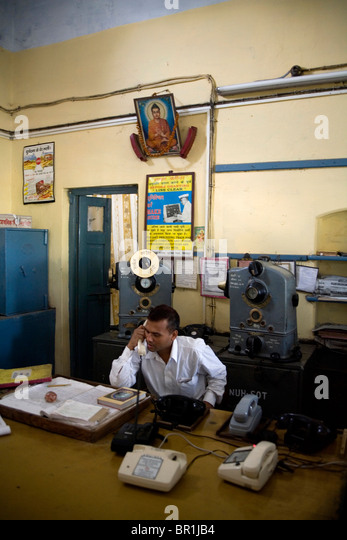Man on the phone on his office at Naugarh train station, Siddharthnagar, Uttar Pradesh, India, Asia. - Stock Image