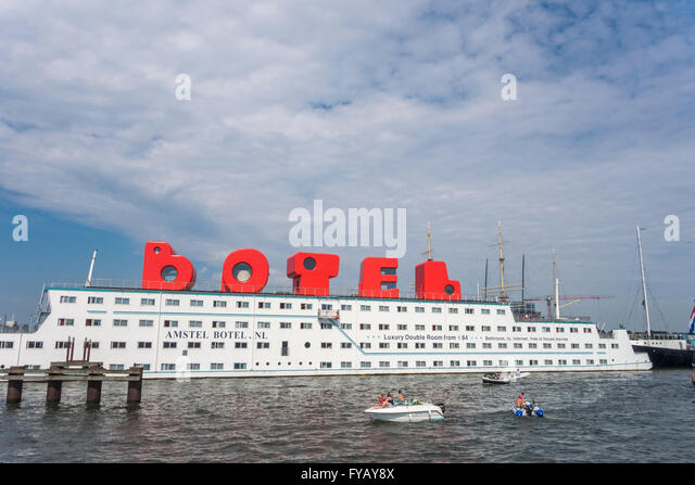 Amsterdam floating hotel Amstel Botel in Amsterdam IJ harbor with guest rooms in the BOTEL logo loft characters - Stock Image