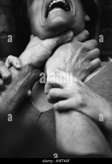 Hands strangling woman, close-up, b&w - Stock Image