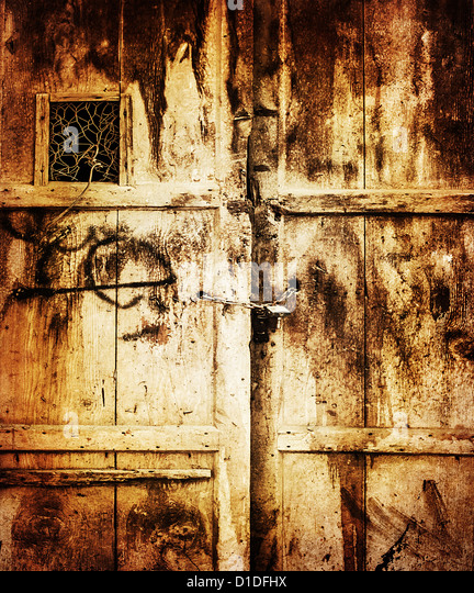 Image of old wooden dirty door background, retro style photo, grungy entrance into house, locked door, aged scratched - Stock Image