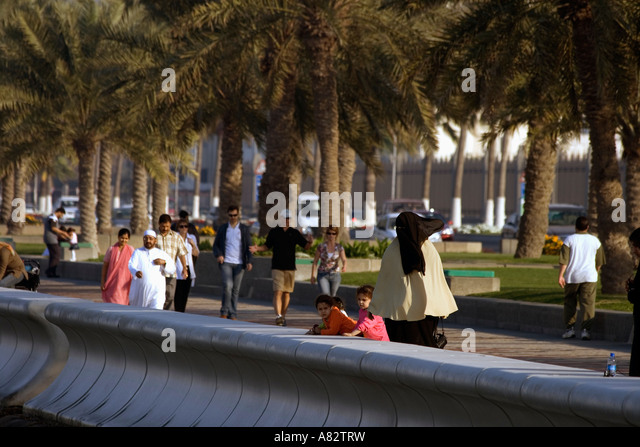 Qatar Doha corniche promenade people veiled women - Stock Image