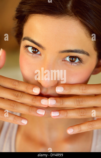 Woman with Hands Covering Mouth, Close-up View - Stock-Bilder