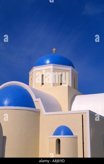 Greece Santorini curch with blue domes and cross - Stock Image