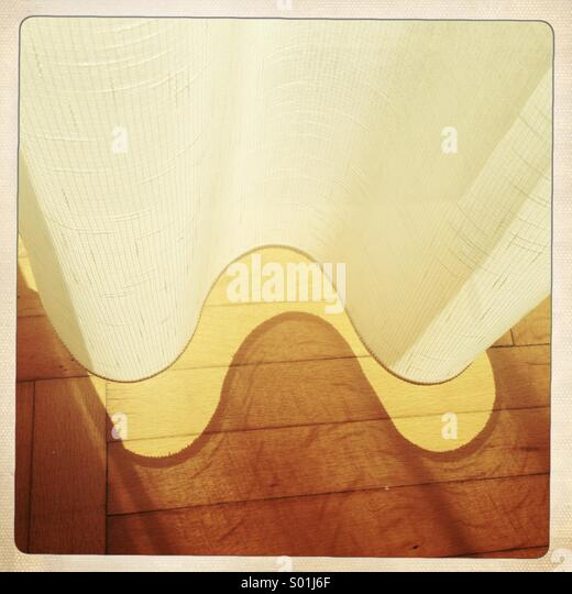 curtain,floor and light - Stock Image