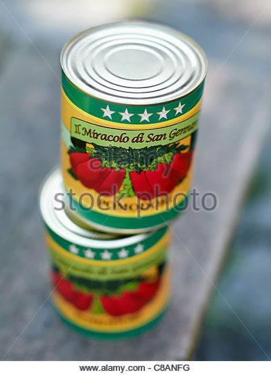 Cans of peeled potatoes - Stock Image