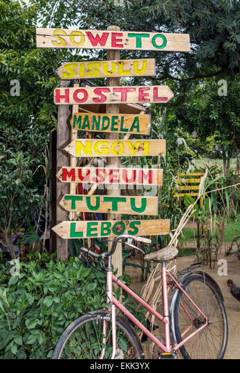 South Africa African Johannesburg Soweto Lebo's Backpackers Hostel sign directional directions - Stock Image