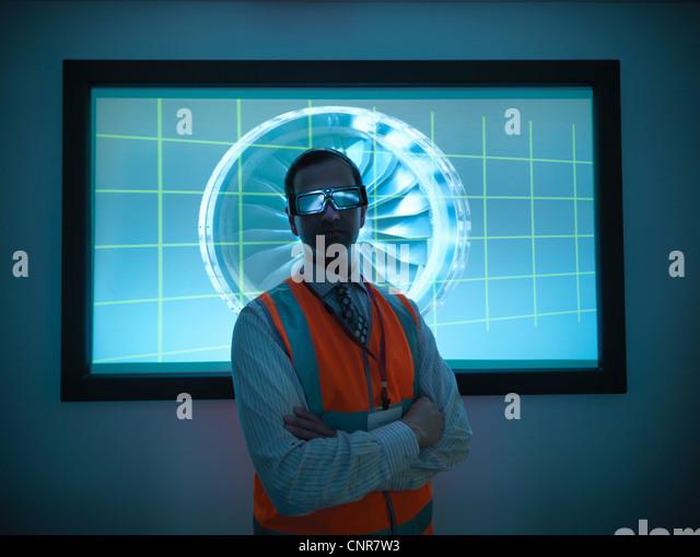Scientist wearing 3D glasses in lab - Stock Image