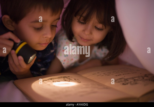 Under covers stock photos under covers stock images alamy reading under the covers by torchlight girl aged four years boy aged six stock image sciox Gallery