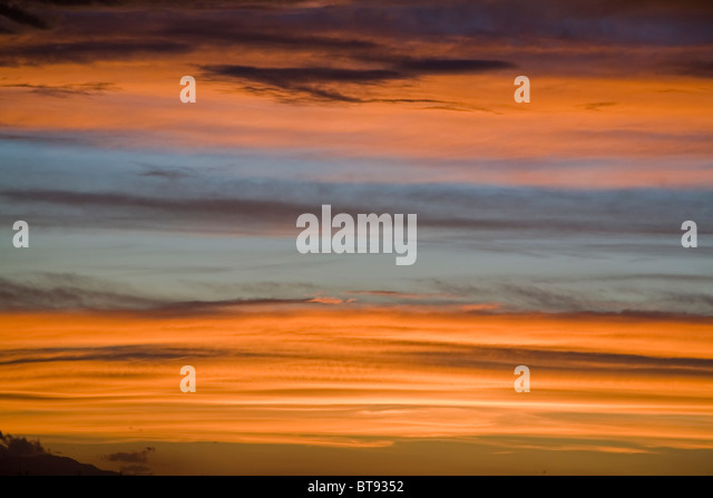 Golden sunset clouds background - Stock Image