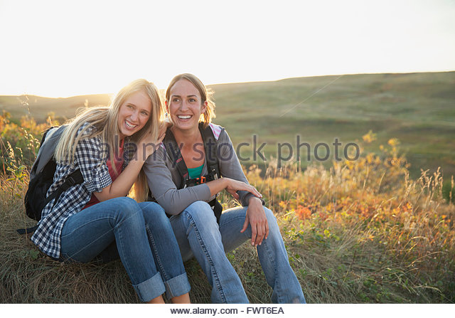 Two women taking a rest from hiking. - Stock Image