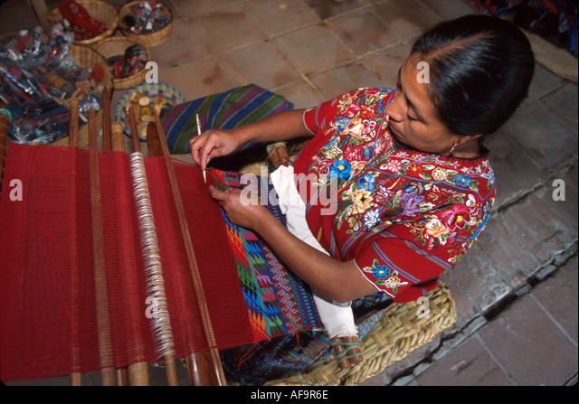 Guatemala La Antigua colonial capitol until earthquake Cakchiquel Indigenous woman weaving - Stock Image