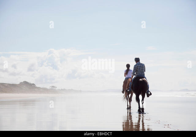 Horse riding, Pakiri Beach, Auckland, New Zealand - Stock-Bilder
