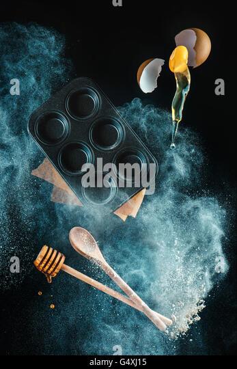 Kitchen mess: baking honey muffins - Stock Image