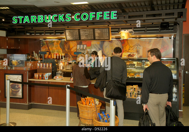 Texas Houston George Bush Intercontinental Airport IAH concourse gate area Starbucks Coffee cafe line queue - Stock Image