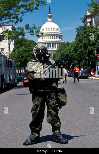 A soldier dressed in hazmat biochemical protection guards the US Capitol building during a drill, Washington, DC - Stock Image