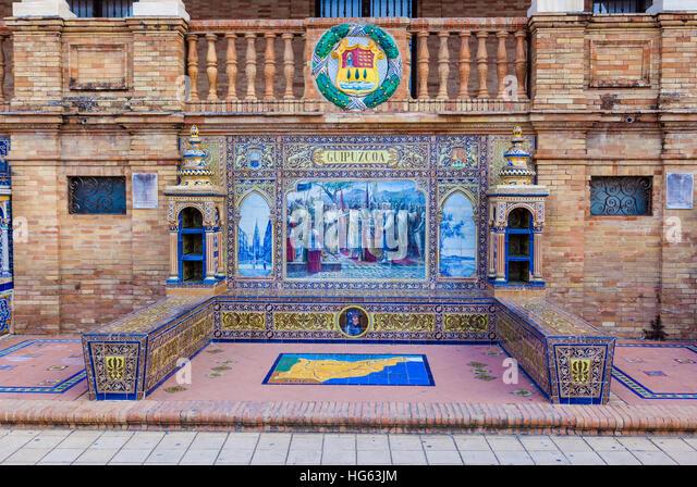 Glazed tiles bench of spanish province of Guipuzcoa at Plaza de Espana, Seville, Spain - Stock Image