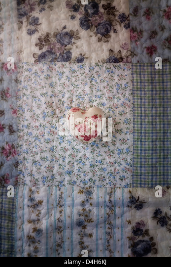a heart with roses on a vintage plaid - Stock-Bilder