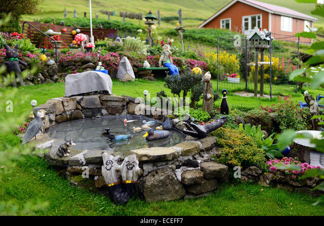 Artistically decorated house garden in village of Gjójv, Eysturoy, Faroe Islands - Stock-Bilder