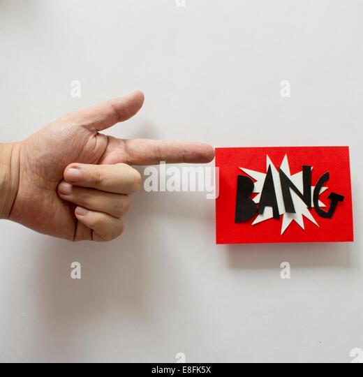 Conceptual toy Gun firing BANG flag - Stock Image