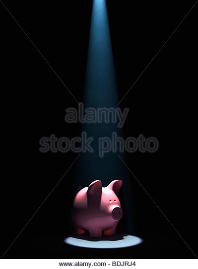 Piggy bank in spotlight - Stock-Bilder