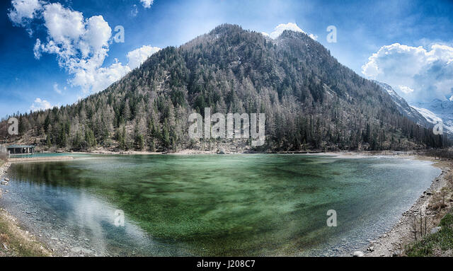 Lake of the Fairies with mountain and blue sky in background near little village of Macugnaga - Stock Image