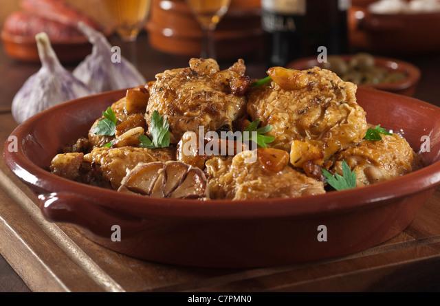 Pollo al ajillo. Chicken with garlic. Spanish food - Stock Image