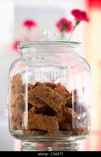 Cookies in a jar at a restaurant - Stock Image