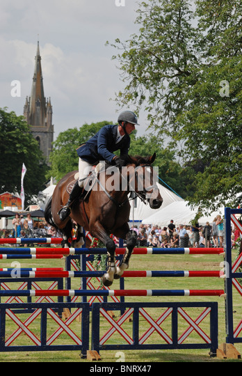Show jumping at the Heckington Show, Lincolnshire, England. - Stock Image
