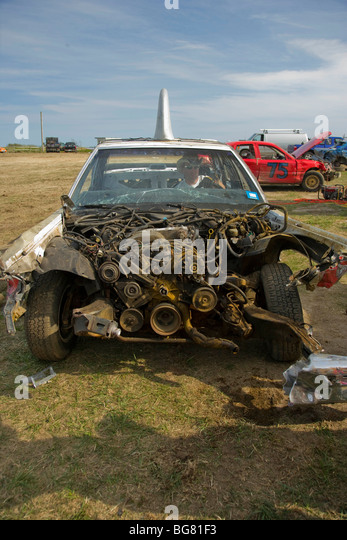 With the front of the engine compartment torn away, this car is still able to compete in the Demolition Derby. - Stock Image