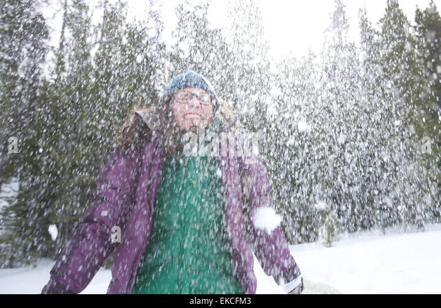 Woman laughing in snow - Stock Image
