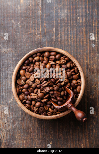 Coffee beans in ceramic bowl - Stock Image