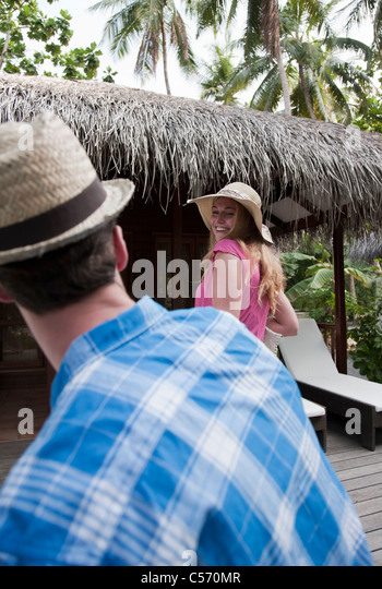 Couple walking in tropical resort - Stock-Bilder