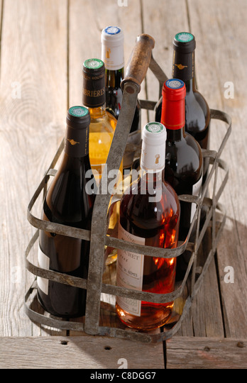 Bottles of wine in bottle carrier - Stock Image
