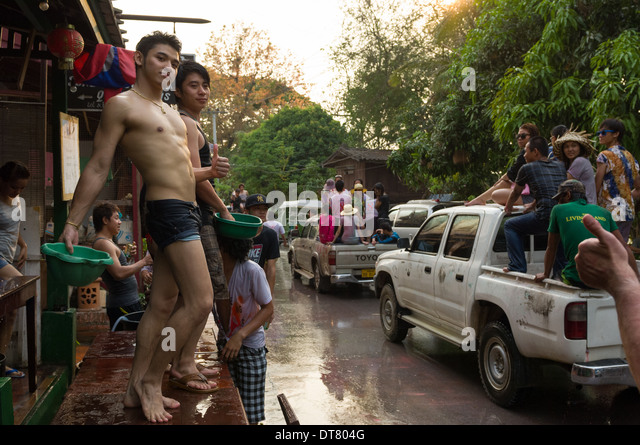 Camp Lao boys taking part in water fights on Mue Nau, the middle day of Lao New Year (Pi Mai Lao), Luang Prabang, - Stock Image