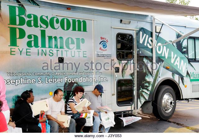 Miami Florida Liberty City Jessie Trice Community Health Center fair free care exam mobile clinic van Bascom Palmer - Stock Image