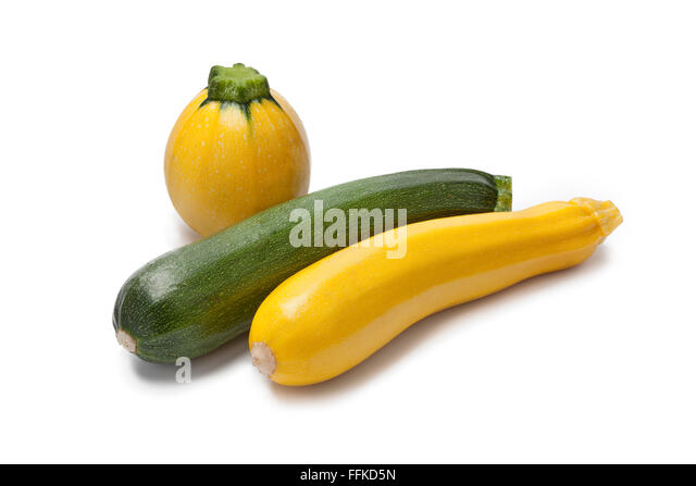 Yellow, green and round courgette on white background - Stock Image