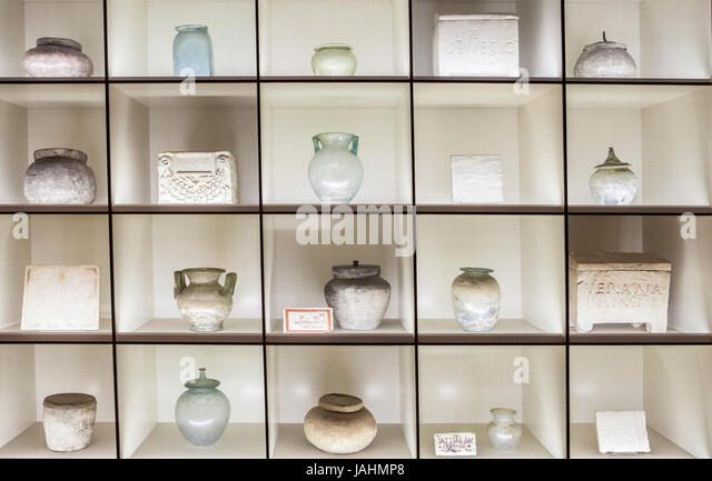 Madrid, Spain - February 24, 2017: Shelves with funeral urns for incineration at National Archeological Museum of - Stock Image