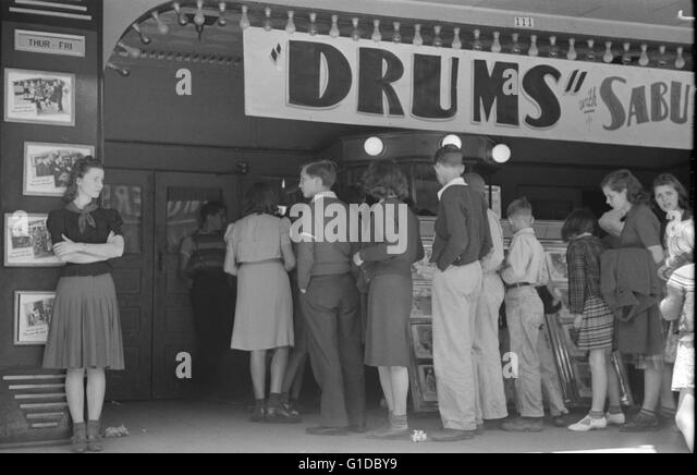 American schoolchildren going to the movies, San Augustine, Texas 1939 - Stock Image