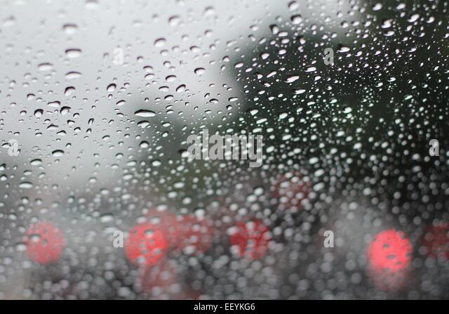 Raindrops on a window during winter. - Stock-Bilder