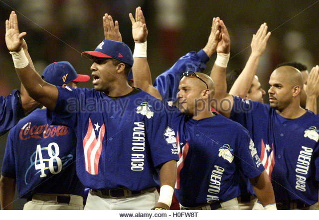 Puerto Rico's Bayamon Cowboys celebrate beating Dominican Republic's  Licey Tigers in the 2002 Caribbean - Stock Image