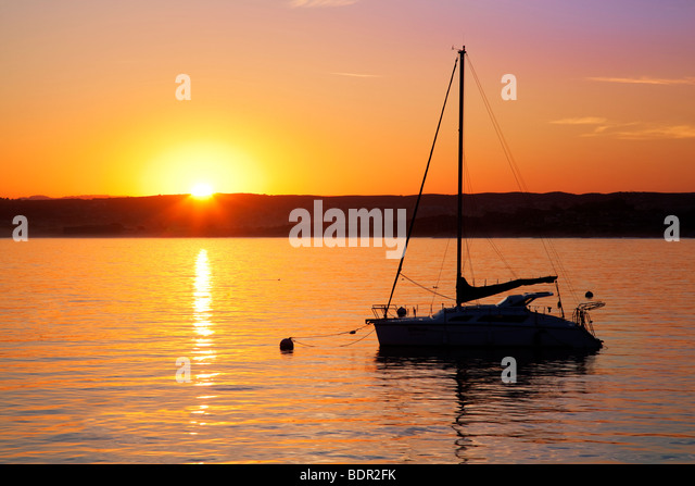 Sunrise and sailboat. Monterey Bay, Caliifornia - Stock Image