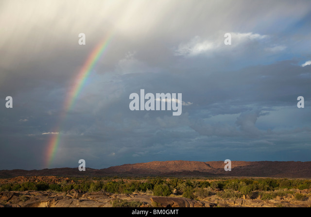 Rainbow on dramatic sky, Augrabies Falls National Park, Northern Cape Province, South Africa - Stock Image