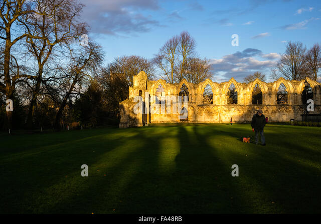 Walking in the shadows of history, Museum Gardens, York, Yorkshire, England, UK - Stock Image