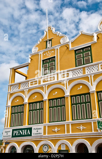 Landmark historic yellow Penha building (1708) on the Willemstad waterfront, Curacao - Stock Image