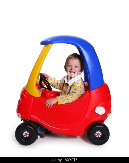 Boy in Toy Car - Stock Image
