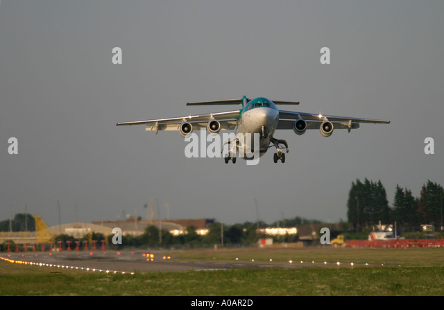 Aer Lingus British Aerospace BAe 146 taking off at London City Airport UK - Stock Image