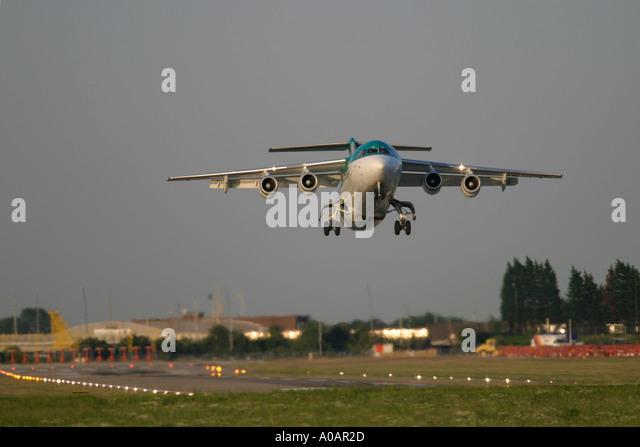 Aer Lingus British Aerospace BAe 146 taking off at London City Airport UK - Stock Image