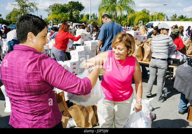 Miami Florida Alpha Omega Church Christian religion Thanksgiving turkey give-away give away free food needy volunteers - Stock Image