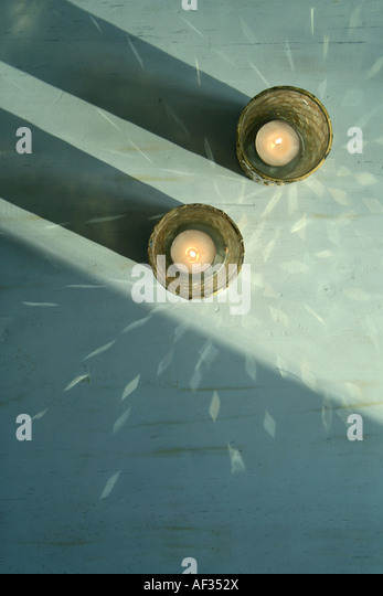 two candles in light creating a decorative pattern - Stock Image