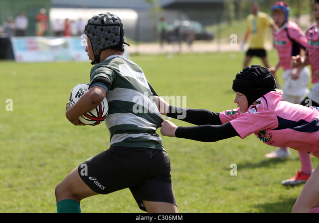 Young boys playing rugby at the Portugal Rugby Youth Festival 2011, Lisbon. - Stock Image